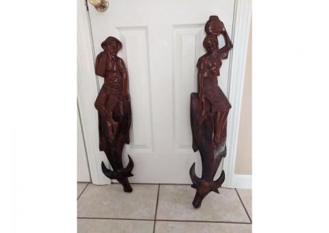 Lady and man bull. Carved on wood.
